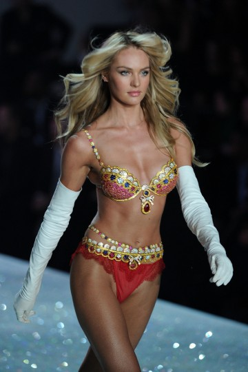 Model Candice Swanepoel, wears the Royal Fantasy Bra and Belt valued at 10 million USD, walks the runway at the 2013 Victoria's Secret Fashion Show on November 13, 2013 in New York City. The Royal Fantasy Bra Gift Set includes a custom Dream Angels Demi silhouette bra and matching belt adorned with over 4,200 precious gems handset with rubies, diamonds, blue and yellow sapphires all set in 18 karat gold. The bra features a pear shaped center ruby weighing 52 carats. (Bryan Bedder/Getty Images for Swarovski)