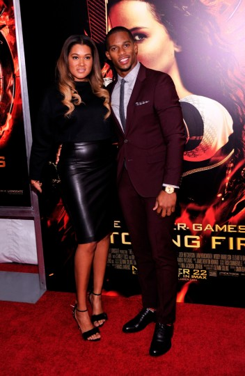 "NFL Player Victor Cruz (R) and Elaine Watley attend the ""Hunger Games: Catching Fire"" New York Premiere at AMC Lincoln Square Theater in New York City. (Stephen Lovekin/Getty Images)"