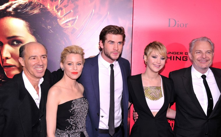 "Elizabeth Banks, Liam Hemsworth, Jennifer Lawrence, and Francis Lawrence attend the ""Hunger Games: Catching Fire"" New York Premiere at AMC Lincoln Square Theater in New York City. (Stephen Lovekin/Getty Images)"