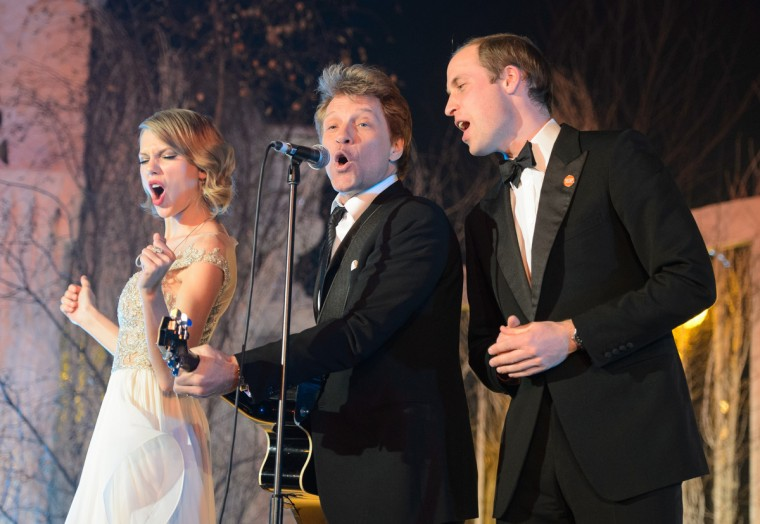 Taylor Swift, Jon Bon Jovi and Prince William, Duke of Cambridge sing on stage at the Centrepoint Gala Dinner at Kensington Palace in London, England. (Dominic Lipinski/Getty Images)
