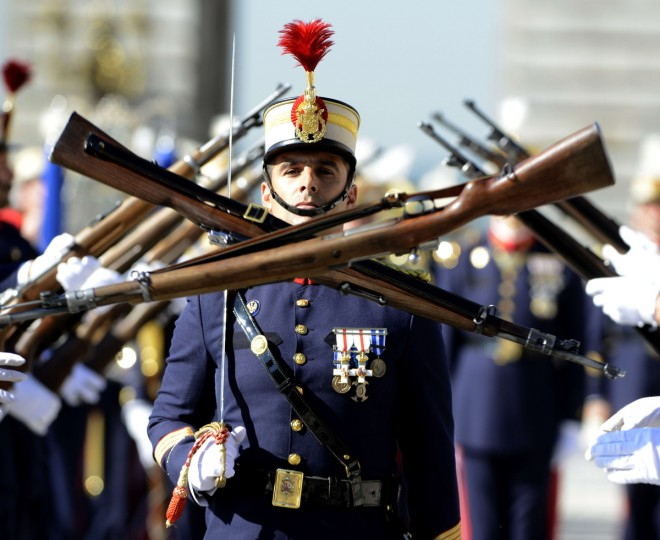A members of the Spanish Royal Guard marches during the monthly changing of the guard ceremony at the royal palace in Madrid. (Gerard Julien/Getty Images)