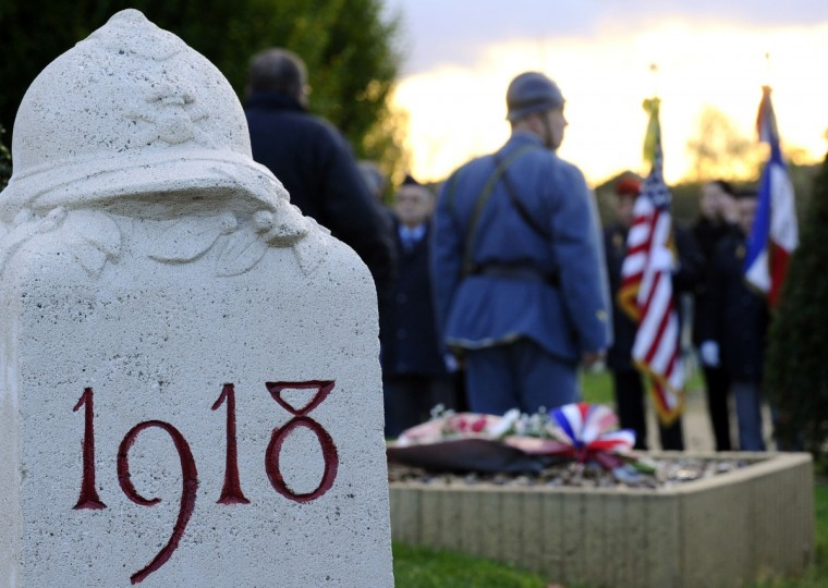 Veterans take part in a ceremony in tribute to seven unknown soldiers, on November 10, 2013 at the Faubourg-Pave French Cemetery in Verdun, eastern France. Eight bodies of soldiers who fought for France during World War I, but that could not be identified were exhumed in eight areas where had occurred the bloodiest battles: in Flanders, Artois, in the Somme, in Ile-de-France, at the Chemin des Dames, in Champagne, Lorraine and Verdun. One of the coffin was moved in 1920 under the Arc de Triomphe, in Paris, but the other seven remained in Verdun. (Jean-Christophe Verhaegen/Getty Images)