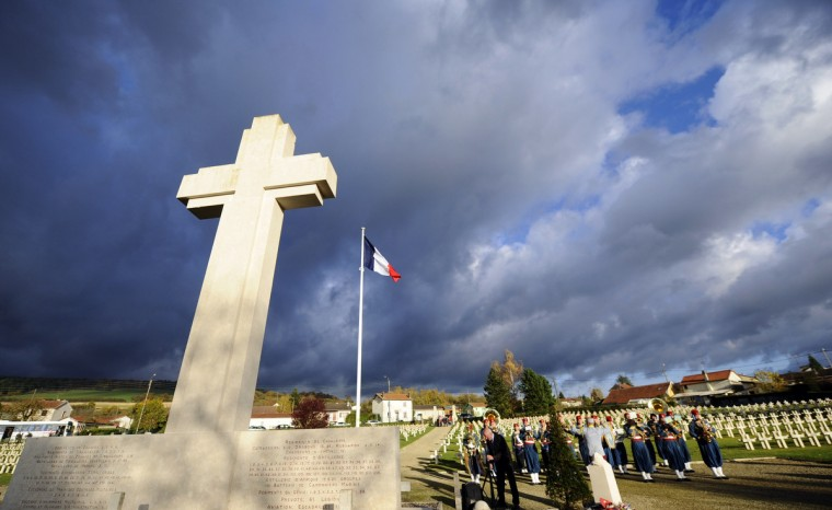 Veterans take part in a ceremony in tribute to seven unknown soldiers, on November 10, 2013 at the Faubourg-Pave French Cemetery in Verdun, eastern France. Eight bodies of soldiers who fought for France during World War I, but that could not be identified were exhumed after the war in eight areas where had occurred the bloodiest battles: in Flanders, Artois, in the Somme, in Ile-de-France, at the Chemin des Dames, in Champagne, Lorraine and Verdun. One of the coffin was moved in 1920 under the Arc de Triomphe, in Paris, but the other seven remained in Verdun. (Jean-Christophe Verhaegen/Getty Images)