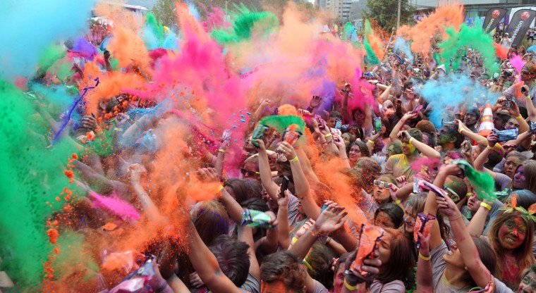 """Runners participate in the""""Color Run"""" across the streets of Santiago on November 10, 2013. Some 15,000 people took part in the five-km race, organizers said. (Hector Retamal/AFP/Getty Images)"""