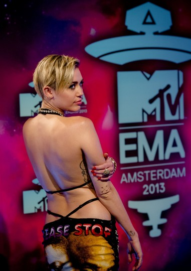 Miley Cyrus poses for a photograph on the red carpet for the MTV Europe Music Awards 2013 ceremony at the Ziggo Dome in Amsterdam, The Netherlands, on November 10, 2013. (Robin Van Lonkhuijsen/AFP/Getty Images)