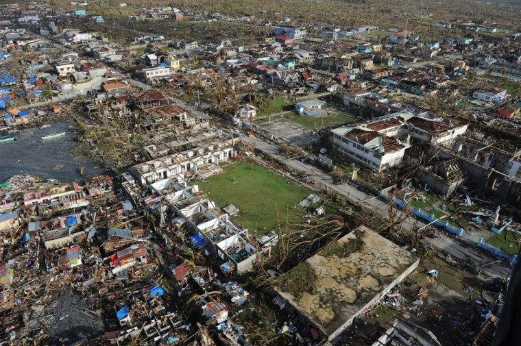 This aerial photo shows destroyed houses in the town of Guiuan in Eastern Samar province, central Philippines on November 11, 2013, four days after devastating Typhoon Haiyan hit the country. Philippines rescue workers struggled to bring aid to famished and destitute survivors on November 11 after the super typhoon that may have killed more than 10,000 people, in what is feared to be the country's worst natural disaster. (Ted Aljibe/Getty Images)