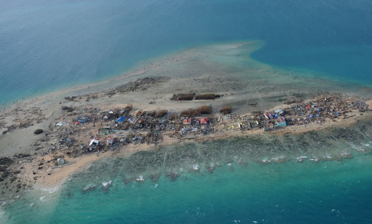 This aerial photo shows the devastation on Victory Island off of the town of Guiuan in Eastern Samar province, central Philippines on November 11, 2013, four days after devastating Typhoon Haiyan hit the country. Philippines rescue workers struggled to bring aid to famished and destitute survivors on November 11 after the super typhoon that may have killed more than 10,000 people, in what is feared to be the country's worst natural disaster. (Ted Aljibe/Getty Images)