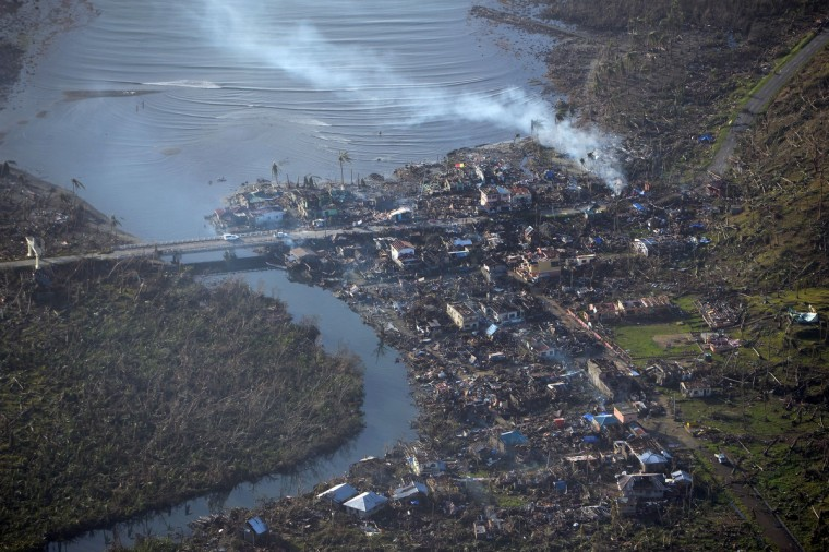 This aerial photo shows typhoon devastation along the coast in Eastern Samar province, central Philippines on November 11, 2013, four days after Typhoon Haiyan hit the country. Philippines rescue workers struggled to bring aid to famished and destitute survivors on November 11 after the super typhoon that may have killed more than 10,000 people, in what is feared to be the country's worst natural disaster. (Ted Aljibe/Getty Images)