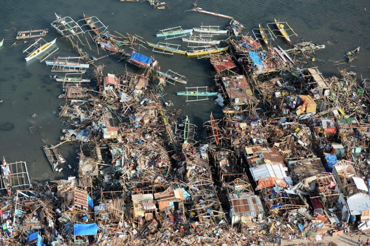 This aerial photo shows destroyed houses along the water in the town of Guiuan in Eastern Samar province in the central Philippines on November 11, 2013 only days after Super Typhoon Haiyan devastated the town on November 8. Philippines rescue workers struggled to bring aid to famished and destitute survivors on November 11 after the super typhoon that may have killed more than 10,000 people, in what is feared to be the country's worst natural disaster. (Ted Aljibe/Getty Images)