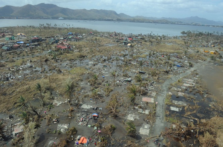 This aerial photo shows a devastated area in the city of Tacloban, Leyte province, in the central Philippines on November 11, 2013, only days after Super Typhoon Haiyan hit the town on November 8. Philippines rescue workers struggled to bring aid to famished and destitute survivors on November 11 after the super typhoon that may have killed more than 10,000 people, in what is feared to be the country's worst natural disaster. (Ted Aljibe/Getty Images)