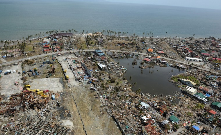 This aerial photo shows destroyed houses in the city of Tacloban, Leyte province, in the central Philippines on November 11, 2013, only days after Super Typhoon Haiyan devastated the town on November 8. Philippines rescue workers struggled to bring aid to famished and destitute survivors on November 11 after the super typhoon that may have killed more than 10,000 people, in what is feared to be the country's worst natural disaster. (Ted Aljibe/Getty Images)