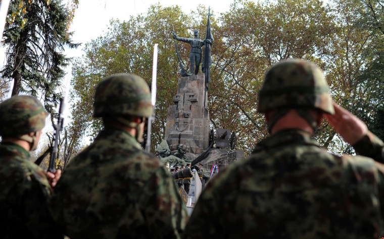 Serbian Army soldiers stand at attention in front of a monument on November 11, 2013 during a Remembrance Day ceremony, marking the 99th anniversary of the end of World War I at the French Soldiers Cemetery in Belgrade. (Andrej Isakovic/Getty Images)