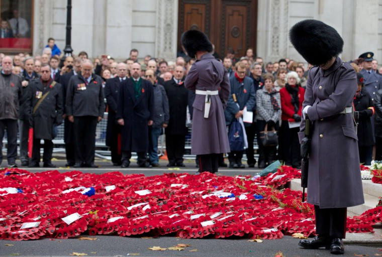 British military personnel, veterans and members of the public, observe a two-minute silence on Armistice Day at the Cenotaph in central London, on November 11, 2013, in memory of Britain's war dead. In the run-up to Armistice Day, many Britons wear a paper red poppy -- symbolising the poppies which grew on French and Belgian battlefields during World War I -- in their lapels. (Andrew Cowie/Getty Images)