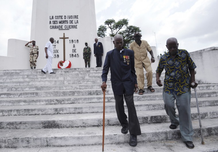 Ivorian World War II veterans leave a monument in memory of WWI and WWII soldiers on November 11, 2013 in Abidjan during the Armistice Day ceremonies marking the end of World War I. (Sia Kambou/Getty Images)