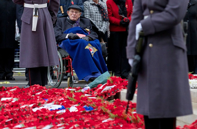 British military veterans take part in a commemorative service on Armistice Day at the Cenotaph in central London, on November 11, 2013, in memory of Britain's war dead. In the run-up to Armistice Day, many Britons wear a paper red poppy -- symbolising the poppies which grew on French and Belgian battlefields during World War I -- in their lapels. (Andrew Cowie/Getty Images)