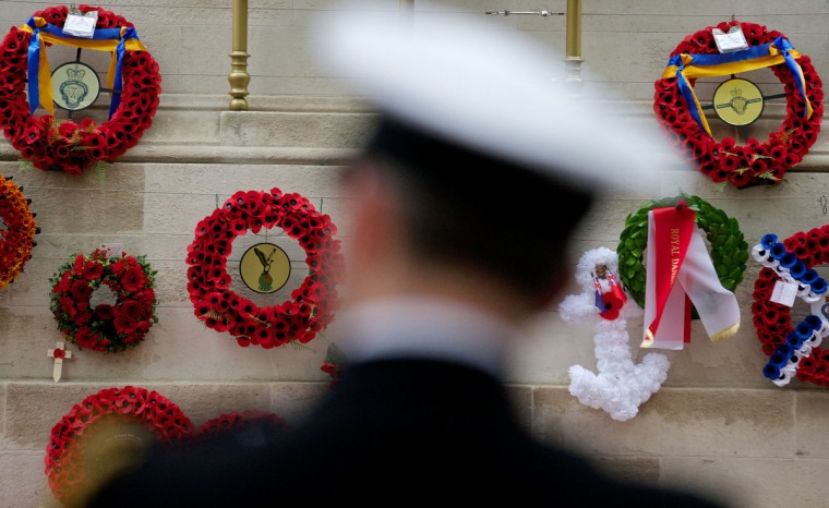 Wreaths are pictured on the Cenotaph memorial during a commemorative service on Armistice Day in central London, on November 11, 2013, in tribute to Britain's war dead. In the run-up to Armistice Day, many Britons wear a paper red poppy -- symbolizing the poppies which grew on French and Belgian battlefields during World War I -- in their lapels. (Andrew Cowie/Getty Images)