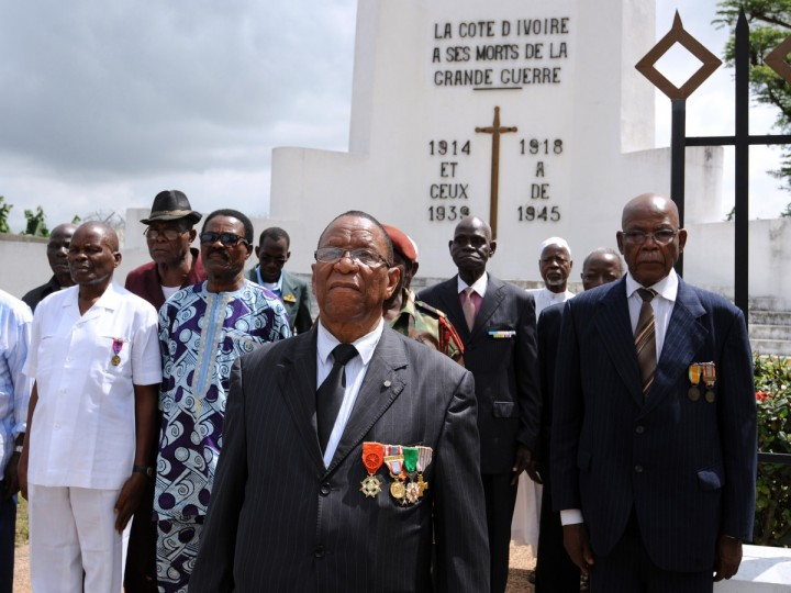 Ivorian World War II veterans pose in front of a monument in memory of WWI and WWII soldiers on November 11, 2013 in Abidjan during the Armistice Day ceremonies marking the end of World War I. (Sia Kambou/Getty Images)