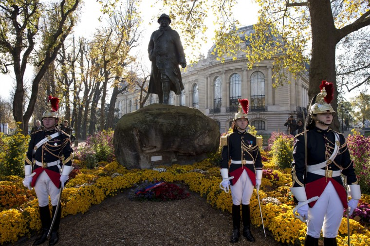 Republican guards stand in front of a statue of late French president Georges Clemenceau during the the Armistice Day ceremonies marking the end of World War I on November 11, 2013 in Paris. (Lionel Bonaventure/Getty Images)