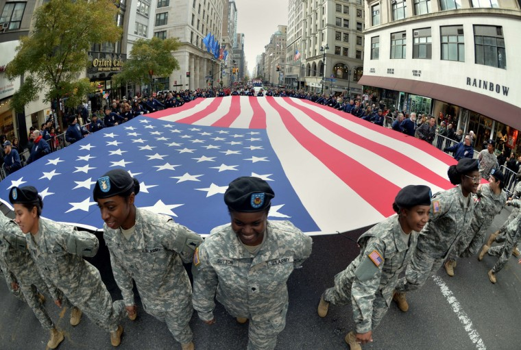 Members of the New York State National Guard carry a large flag during the annual Veterans Day Parade November 11, 2013 on Fifth Avenue in New York. The parade honored all veterans with a special salute to women in uniform. (Stan Honda/Getty Images)