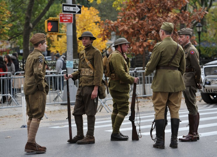 Men dressed in World War I vintage US Army uniforms gather just before the annual Veterans Day Parade November 11, 2013 on Fifth Avenue in New York. (Stan Honda/Getty Images)