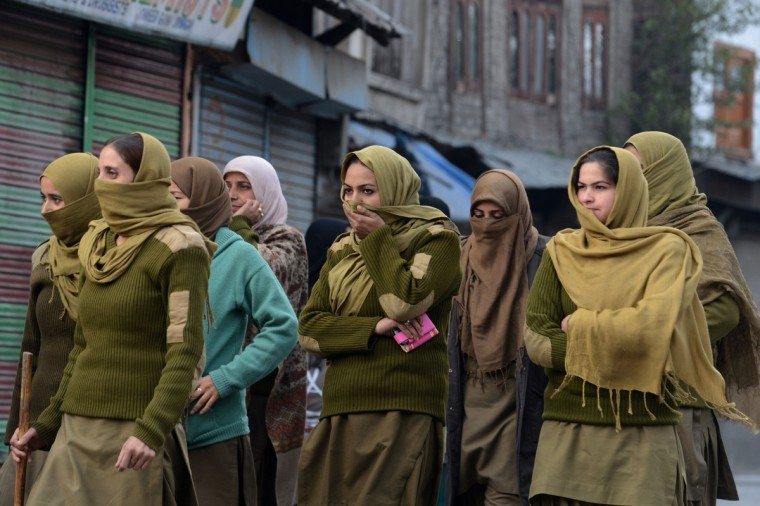 Indian policewomen patrol a street during restrictions for the eighth day of Muharram in Srinagar. Authorities imposed restrictions in parts of Srinagar, the summer capital of Kashmir, to thwart planned Muharram processions as police detained more than a dozen protesters and fired teargas to disperse participants. (Tauseef Mustafa/Getty Images)