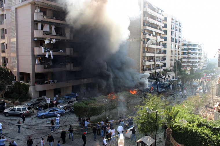 Flames rise from the site of a blast in Bir Hassan neighborhood in the southern Beirut. At least 22 people were killed in a double bomb attack outside the Iranian embassy in Beirut, including an Iranian cultural advisor, government sources told AFP. (Getty Images)