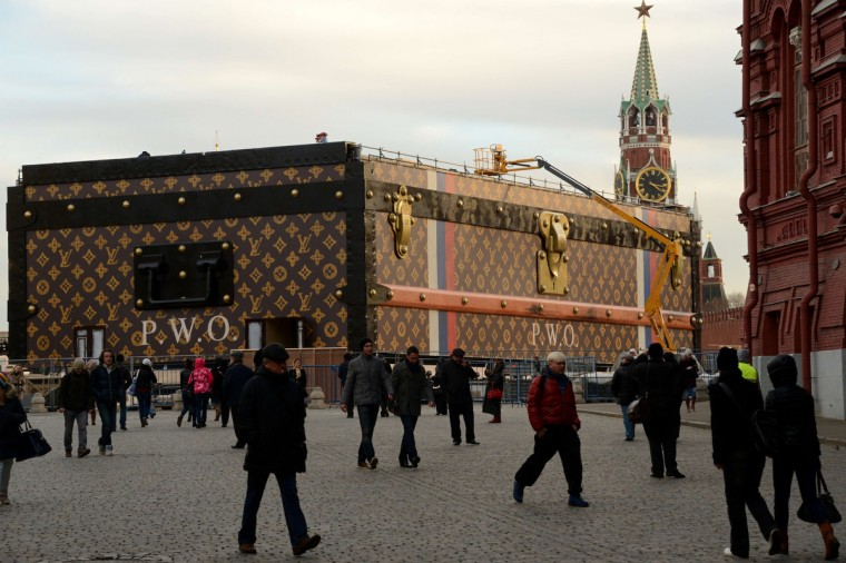 People walk past a giant Louis Vuitton trunk on Red Square in Moscow. The huge trunk was assembled today in the heart of Moscow near the Kremlin as a part of the upcoming exhibition to mark the famous owners of the iconic trademark, Russian media reported. (Kirill Kudryavtsev/Getty Images)