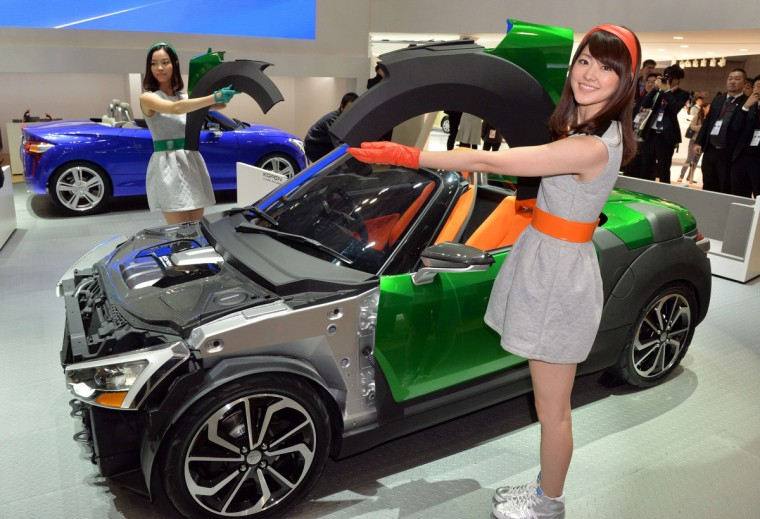 "Japan's automaker Daihatsu Motor displays the company's mini sports car ""Kopen"" at the press preview of the Tokyo Motor Show in Tokyo on November 20, 2013. (Yoshikazu Tsuno/Getty Images)"