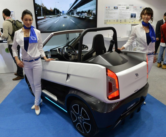 Japan's auto parts and navigation device maker Car Mate displays a concept electric commuter car at the press preview of the Tokyo Motor Show in Tokyo on November 20, 2013. (Yoshikazu Tsuno/Getty Images)