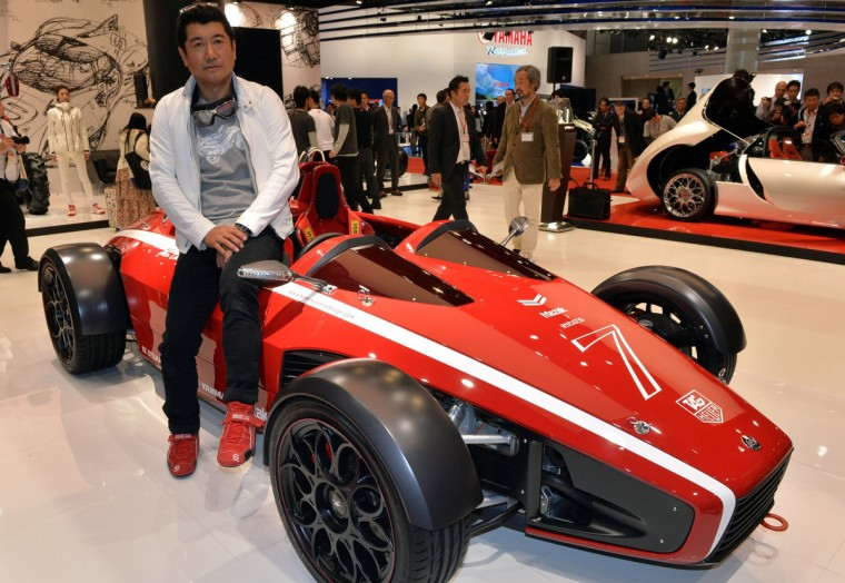 """Japanese car designer Ken Okuyama, who designed a Ferrari car, displays the formula car designed """"Kode 7"""", equipped with a 1.6-litter engine to drive two-seater body which will be priced 8.5 million yen (85,000 USD) at the press preview of the Tokyo Motor Show in Tokyo on November 20, 2013. (Yoshikazu Tsuno/Getty Images)"""