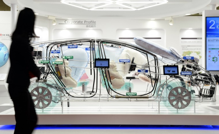 "The skeleton-shape ""Toyota Aqua"" is seen on display at the Toyoda Gosei booth with the company's plastic parts on it during the Tokyo Motor Show in Tokyo on November 20, 2013. (Toshifumi Kitamura/Getty Images)"