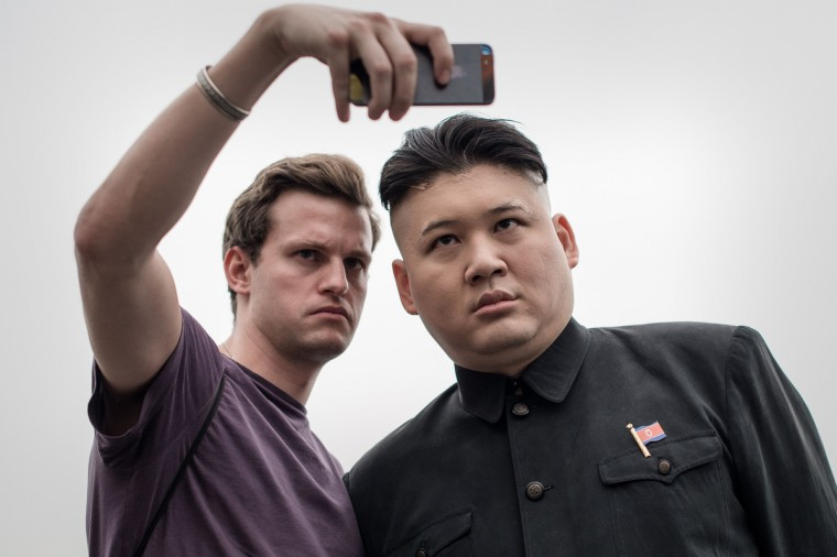 A Hong Kong born Australian named Howard (R) poses with a tourist in Hong Kong. Howard is considered the world's first professional Kim Jong-Un impersonator. (Philippe Lopez/Getty Images)