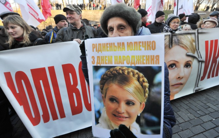 A woman holds a portrait of jailed Ukrainian opposition leader and former prime minister Yulia Tymoshenko during a rally of opposition supporters in Kiev in front of the government headquarters in Kiev. EU officials had hoped to sign the so-called Association Agreement with Kiev at a two-day summit that starts on November 28 in Vilnius. But the Ukrainian government suddenly halted negotiations citing concerns that the deal in its current form would harm the country's economy as well as trade and economic relations with its giant eastern neighbor. Ukraine said on November 27 it still wanted to reach a historic agreement with the European Union on closer relations despite breaking off talks on the pact in a shock move that set off mass protests. (Genya Savilov/Getty Images)