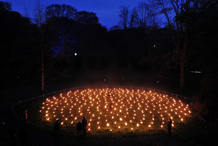 Staff and visitors view a fire mandala display during a preview for the Christmas at Kew event at Kew Gardens in south west London. (Carl Court/Getty Images)