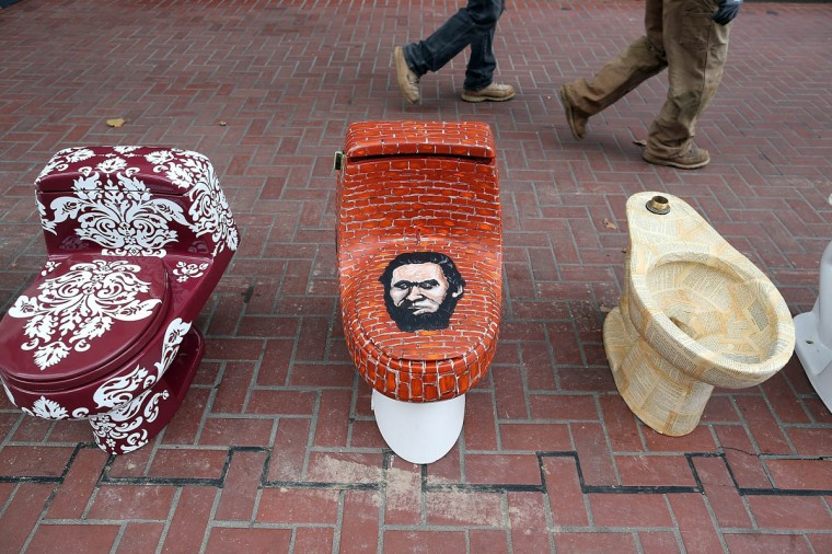 Decorated toilets are displayed as part of a public art installation to mark World Toilet Day and to bring attention to a project to convert retired MUNI buses into mobile showers for the homeless in San Francisco, California. Lava Mae founder Doniece Sandoval coordinated the public art installation of decorated toilets to raise awareness about the millions of people around the world who do not have access to clean and private toilets. The installation also promotes the nonprofit Lava Mae's project to convert old San Francisco municipal buses into mobile showers for homeless people in the city. (Justin Sullivan/Getty Images)