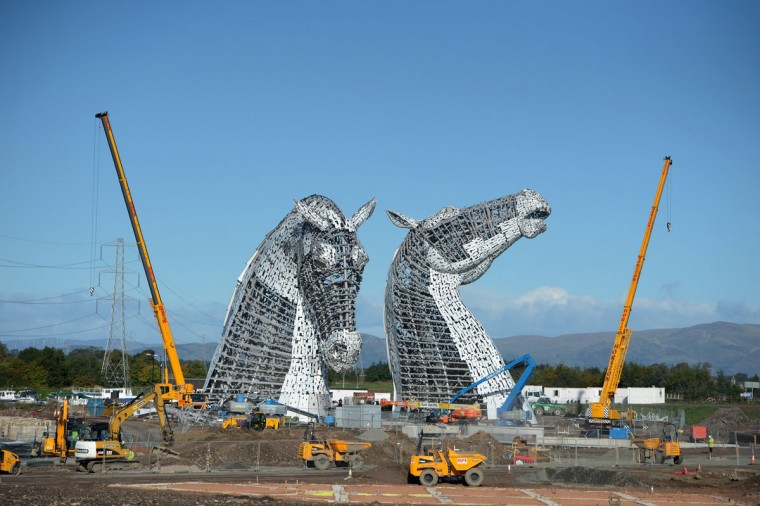 Work continues on The Kelpies sculptures at the eastern entrance to the Forth and Clyde canal on October 10, 2013 in Falkirk, Scotland. The two Kelpie heads are positioned at a specially constructed canal lock and basin part of the Helix project, each weighing 300 tonnes and standing 100 feet tall. The structure was designed by sculptor Andy Scott as a monument to horse powered heritage across Central Scotland. (Jeff J Mitchell/Getty Images)