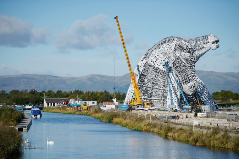 Work continues on The Kelpies sculptures at the eastern entrance to the Forth and Clyde canal on October 9, 2013 in Falkirk, Scotland. The two Kelpie heads are positioned at a specially constructed canal lock and basin part of the Helix project, each weighing 300 tonnes and standing 100 feet tall. The structure was designed by sculptor Andy Scott as a monument to horse powered heritage across Central Scotland. (Jeff J Mitchell/Getty Images)