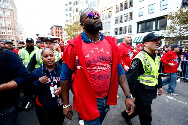 David Ortiz #34 of the Boston Red Sox walks down Boylston Street near the finish line of the Boston Marathon during the World Series victory parade on November 2, 2013 in Boston, Massachusetts. (Jared Wickerham/Getty Images)