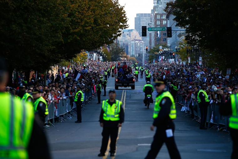 Members of the Boston Police Department prepare for the floats carrying members of the Boston Red Sox to travel down Boylston Street during the World Series victory parade on November 2, 2013 in Boston, Massachusetts. (Jared Wickerham/Getty Images)