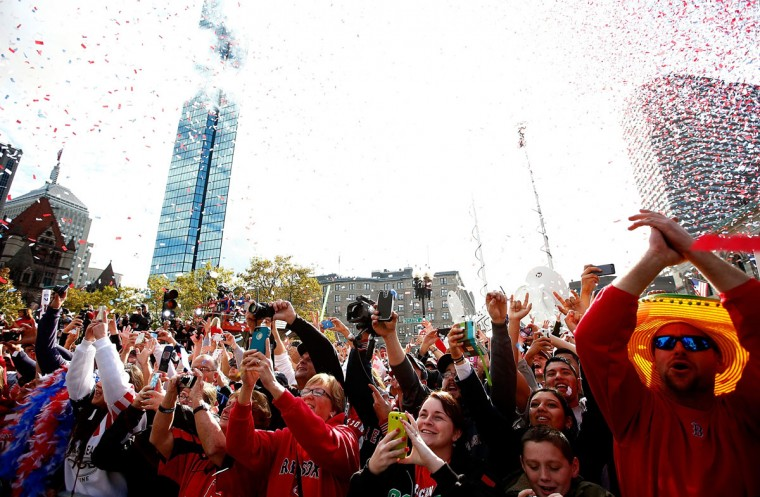 Boston Red Sox fans cheer on Boylston Street during the World Series victory parade on November 2, 2013 in Boston, Massachusetts. (Jared Wickerham/Getty Images)