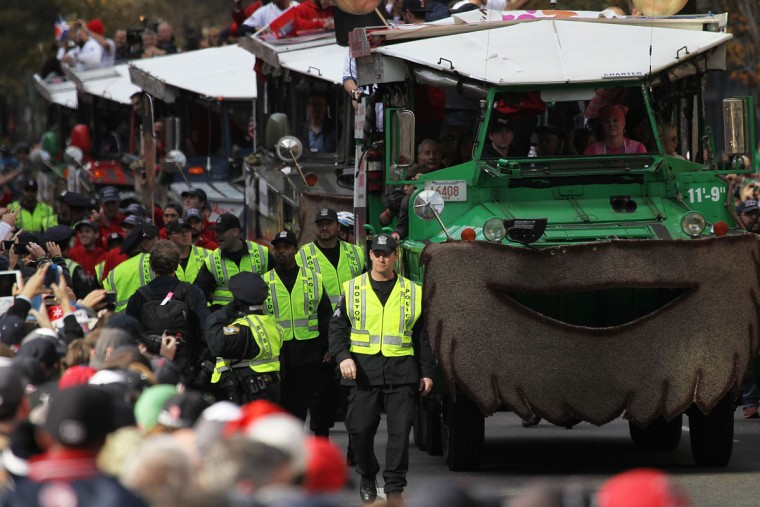 Police escort Duck boats as they made their way down Boylston Street where fans gathered for the World Series victory parade for the Boston Red Sox on November 2, 2013 in Boston, Massachusetts. (Gail Oskin/Getty Images)
