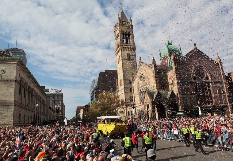 Duck boats make their way down Boylston Street where fans gathered for the World Series victory parade for the Boston Red Sox on November 2, 2013 in Boston, Massachusetts. (Gail Oskin/Getty Images)