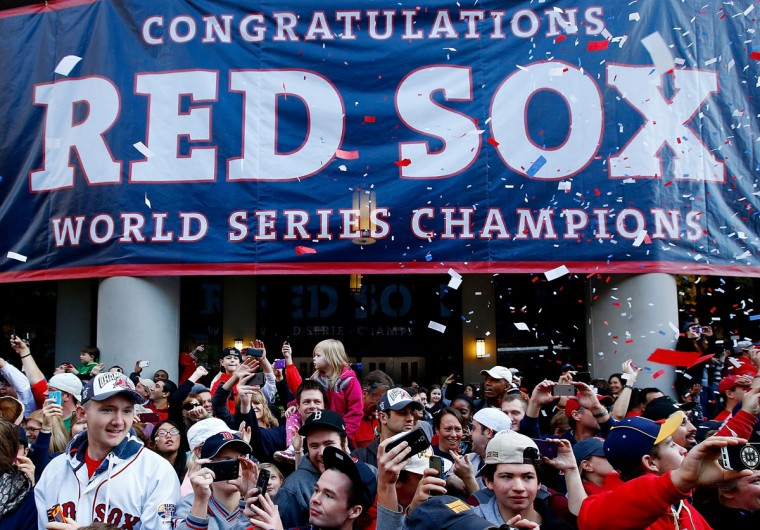 Boston Red Sox fans cheer during the World Series victory parade on November 2, 2013 in Boston, Massachusetts. (Jared Wickerham/Getty Images)