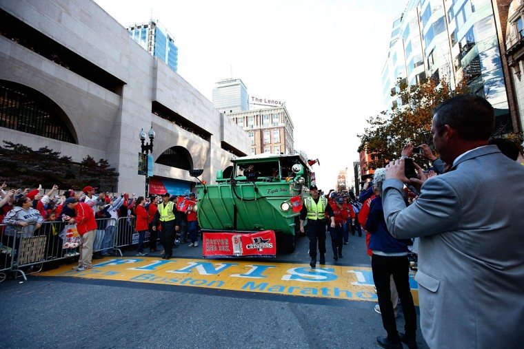 A duck boat carrying members of the Boston Red Sox drives across the finish line of the Boston Marathon on Boylston Street during the World Series victory parade on November 2, 2013 in Boston, Massachusetts. (Jared Wickerham/Getty Images)