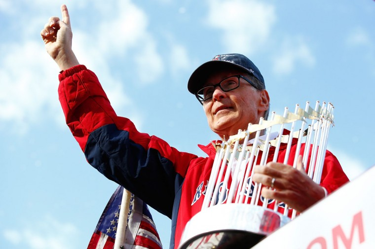 Boston Red Sox owner John Henry holds up the World Series trophy during the World Series victory parade on November 2, 2013 in Boston, Massachusetts. (Jared Wickerham/Getty Images)