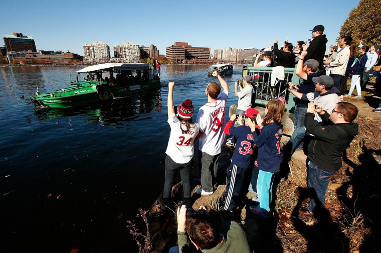 Fans cheer from the shore of the Charles Rivers during the World Series victory parade on November 2, 2013 in Boston, Massachusetts. (Jared Wickerham/Getty Images)