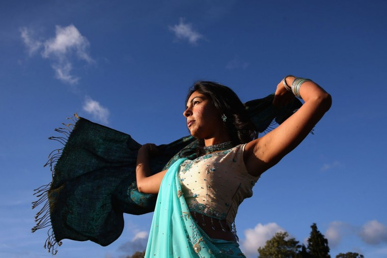 A woman struggles with her scarf in high winds during Diwali celebrations at Bhaktivedanta Manor on November 3, 2013 in Watford, United Kingdom. The festival is an opportunity for Hindus to honour Lakshmi, the goddess of wealth and other gods. Leicester's celebrations are one of the biggest in the world outside India. (Dan Kitwood/Getty Images)