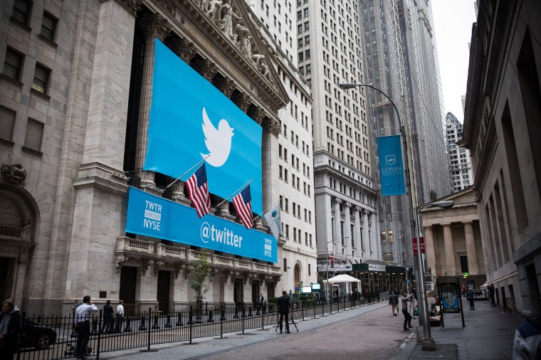 The Twitter logo is displayed on a banner outside the New York Stock Exchange (NYSE) on November 7, 2013 in New York City. Twitter goes public on the NYSE today and is expected to open at USD 26 per share, making the company worth an estimated USD 18 billion. (Andrew Burton/Getty Images)