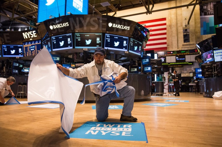 A worker unveils a floor mat bearing the logo of Twitter and the symbol on which Twitter's stock will traded (TWTR) on the floor of the New York Stock Exchange (NYSE) on November 7, 2013 in New York City. Twitter goes public on the NYSE today, it is expected to open at $26 per share, making the company worth an estimated $18 billion. (Andrew Burton/Getty Images)