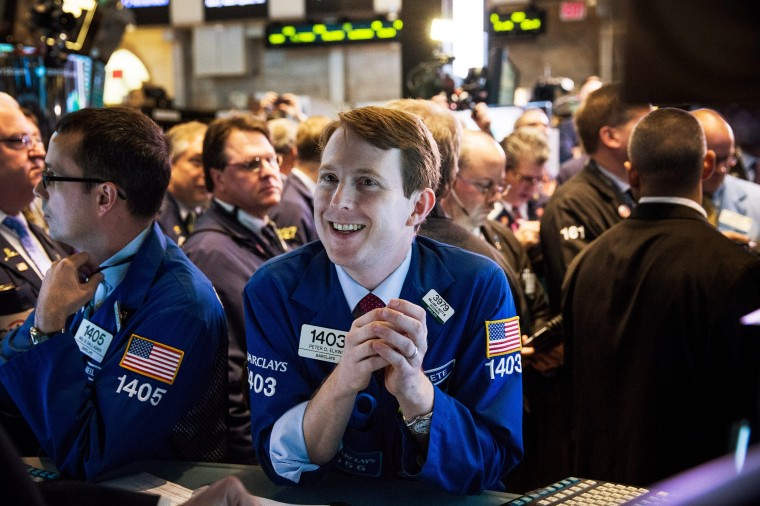 Traders on the floor of the New York Stock Exchange (NYSE) work as Twitter's initial price offering (IPO) is finalized on November 7, 2013 in New York City. Twitter went public November 7, on the NYSE selling at a market price of $45.10, with the initial price being set at $26 on November 6. (Andrew Burton/Getty Images)